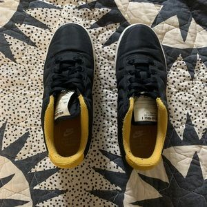 Black and yellow puffy Nike Air Force 1s